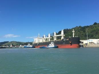 Tugs pushing Tanker