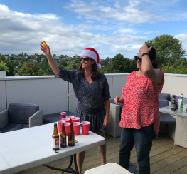 Jodi and Tanya playing beer pong