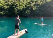 Jodi and B paddle boarding