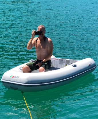 Pete taking photos from the dinghy
